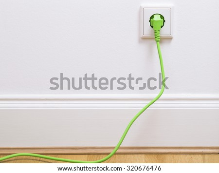 Interior outlet with a green plugged in cable Сток-фото ©
