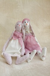 Interior pastel color hares. Handmade designer toy rabbit. Rag bunny for decor in the nursery, kids room. Textile dool from natural materials.