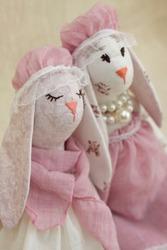 Interior pastel color hares. Handmade designer toy rabbit. Rag bunny for decor in the nursery, kids room.