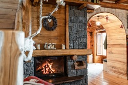 Interior photo of a mountain chalet on the Volcano Etna, volcanic stone fireplace