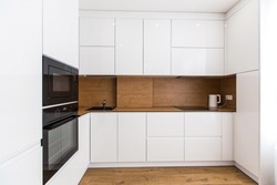 Interior photography, large white kitchen studio in a modern style, minimalism