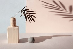 Interior poster in the style of minimalism. Play with shadows and sunlight in a neutral color. A palm leaf in a vase and its shadow reflection. Stone and wood materials. Balance, harmony, boho concept