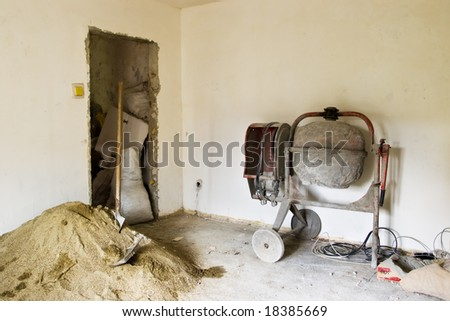 interior renovations with sand and concrete mixer machine