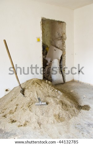 interior renovations with sand and shovel