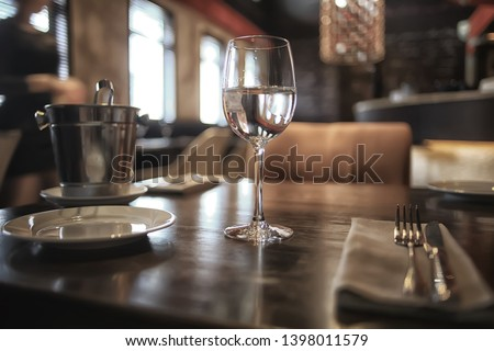 interior restaurant tableware / cutlery and tableware on a table in a cafe, beautiful catering industry #1398011579
