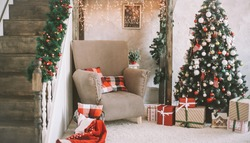 Interior room decorated in Christmas style. A beautiful cozy home decorated for Christmas. Home comfort of modern house. Scandinavian style Christmas home interior, relaxing place. Real photo