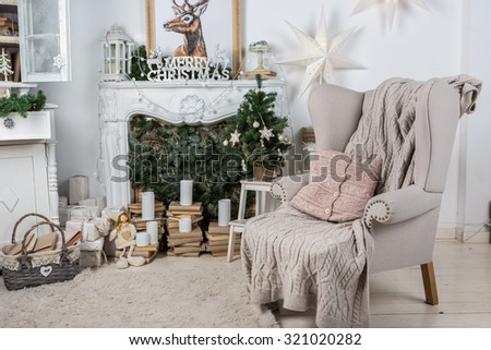 Interior room decorated in Christmas style. No people. An empty chair. Neutral colors. Home comfort of modern home. A series of photos stock photo