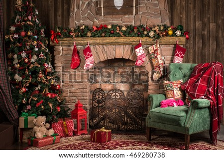 Interior room with elegant Christmas tree, fireplace and a blanket on the couch