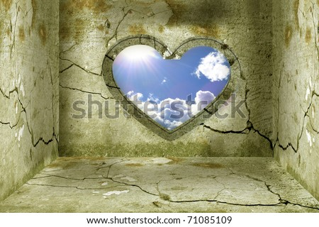Interior room with grunge walls and old door window in the form of heart