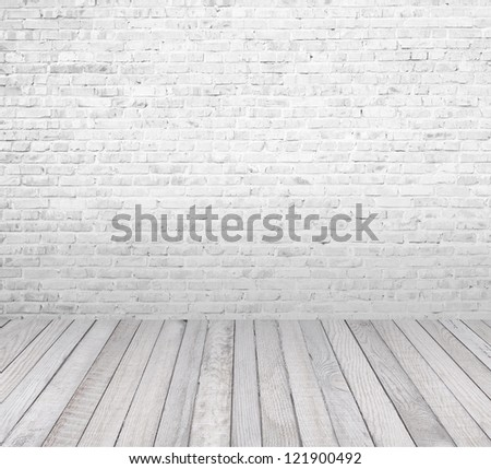 interior room with white brick wall and wooden floor