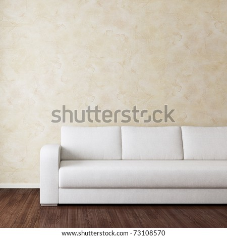 Interior room with white fabric sofa near wall