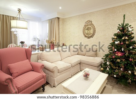 Interior shot of a modern living room with a Christmas tree - stock photo