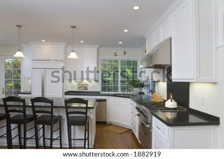 Pictures Black Kitchen Cabinets on Shot Of A Recently Remodeled Kitchen Featuring White Custom Cabinets