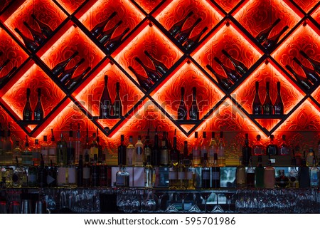 Interior shot of an alcoholic drinks bar in a nightclub.