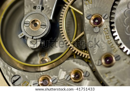 Interior shot of old pocket watch with flywheel in motion. - stock photo