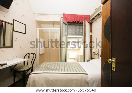 interior small single two star hotel room with shower in room Milan Italy Europe