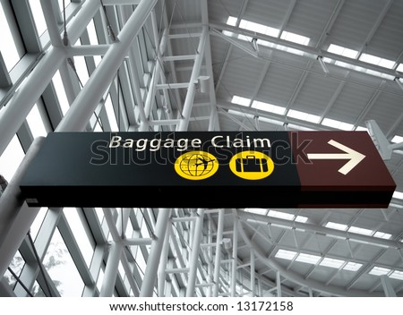 Interior view looking up at Baggage Claim direction sign at Seattle (Sea-Tac) airport