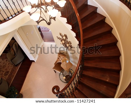Interior view of a foyer with curving staircase