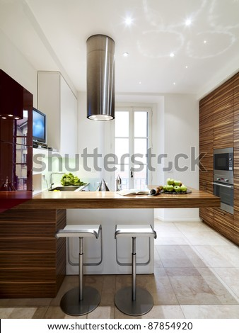 interior view of a modern and luxury wood kitchen with two stool #87854920