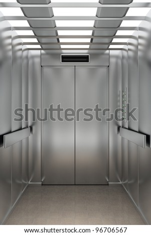 Interior view of a modern elevator facing the entrance doors