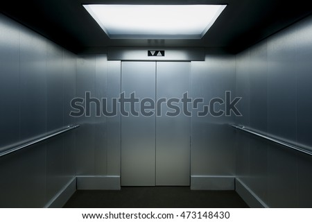 Interior view of a modern elevator with metallic walls. #473148430