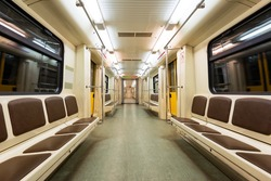 Interior view of a subway car in Moscow, Russia. Inside Russian metro train. Empty subway transport.