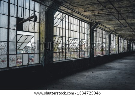 Interior view of an abandoned plant or factory in Detroit. The plant is abandoned and vacant ever since. View of Urban Decay, Urban Exploring. #1334725046