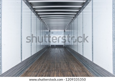 Interior view of empty semi truck dry van commercial trailer #1209335350