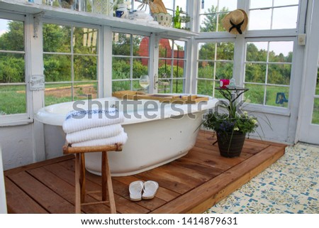 Interior View of Soaking Tub in Greenhouse #1414879631