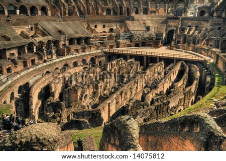 Interior view of the Rome colosseum with tourists. Pseudo HDR image created from a single RAW file