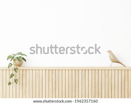 Interior wall mockup in warm neutral minimalist Japandi style with wooden slat wall decor, trailing green plant and bird on empty white background. Close up view, 3d rendering, 3d illustration