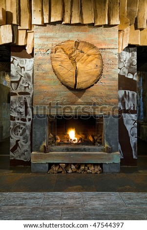 Interior with big rustic fireplace