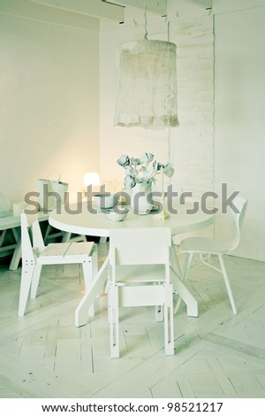 interior with stylish white dinner table