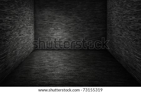 Interior with textured floor and an dark wall