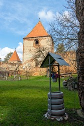 Interior yard of a fortified church with the tower in the background. Fortified church seen from the interior of the walls