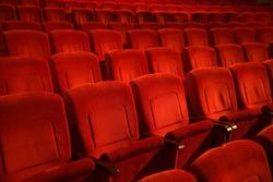 Interiors empty reddish cinema chairs seats in low-key indoors