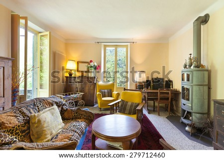 Interiors, nice living room of a rustic home, vintage furniture