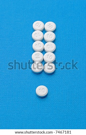 interjection made of pills on blue