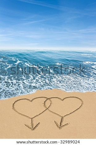 stock photo : interlocking gay male symbols hearts drawn in the sand with ...