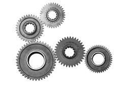 Interlocking metal gears isolated on a white background. Cogwheel industrial background.