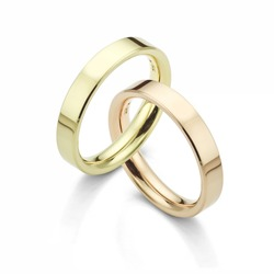 Interlocking Wedding Rings in Yellow Gold and Rose Gold on White Background