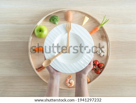 Intermittent fasting IF diet concept with 8-hour clock timer for eating nutritional or keto low carb, high fat and protien food meal healthy dish and 16-hour skipping meal for weight loss