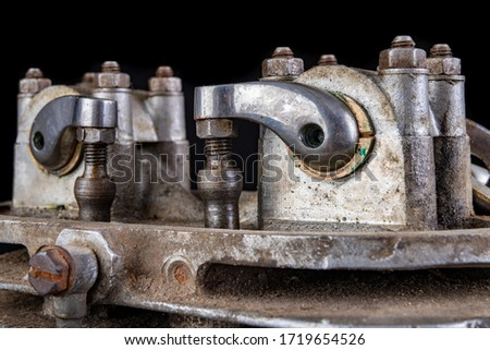 Internal combustion engine tappets in a speedway motorcycle. Timing system in a single-cylinder engine running on ethanol. Dark background. Сток-фото ©