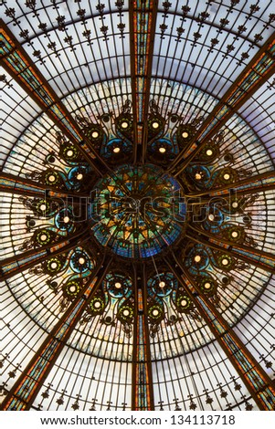 Internal of the iconic mosaic dome of Galeries Lafayette in Paris, France.