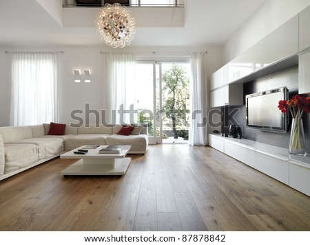 internal view of a modern living room with  wood flooring overlooking on the garden #87878842