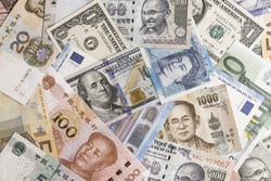 International banknotes from world major countries using as Forex or financial economy background, US dollar, UK pound, Euro, Japanese yen, Indian rupee, Chinese yuan, Thai Baht.