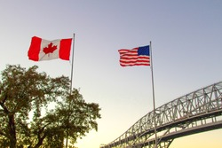 International Border Crossing. Sunset at the Blue Water Bridge border United States and Canada crossing. The bridge connects Port Huron, Michigan and Sarnia, Ontario.