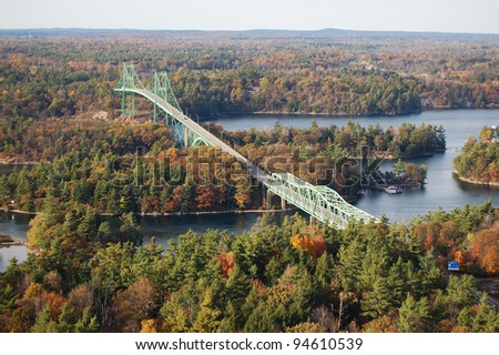 International bridge between USA and Canada in Thousand Islands Region in fall, New York State, USA