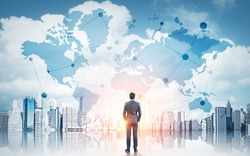 International business concept with businessman on New York city background with network on map and sunlight