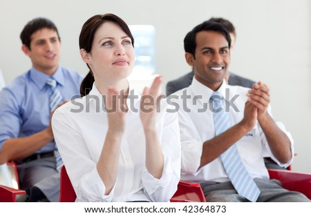 International business people clapping at a conference. Business concept.